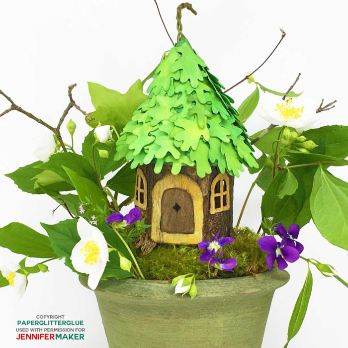 DIY Fairy House with a leaf roof made entirely from paper and glue with a full tutorial, including free templates and SVG cut files! #cricutmade #fairyhouse #papercraft #svgcutfiles