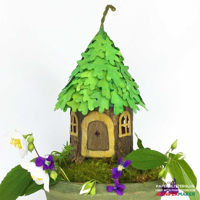 DIY Fairy House with an oak leaf roof made entirely from paper and glue with a full tutorial, including free templates and SVG cut files! #cricutmade #fairyhouse #papercraft #svgcutfiles