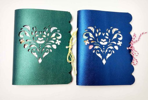 Green and blue faux leather journals designed by JenniferMaker and made by AmyGonnaCraft