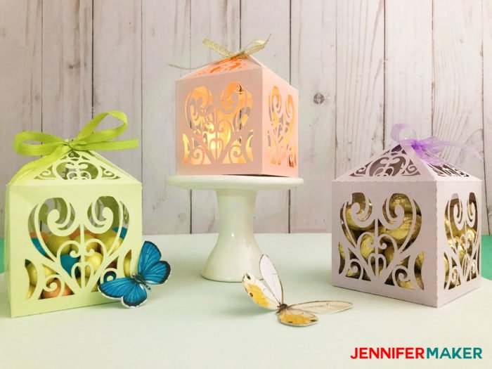 Green, pink, and lavender paper filigree diy favor box or treat box made with shimmer paper on a Cricut