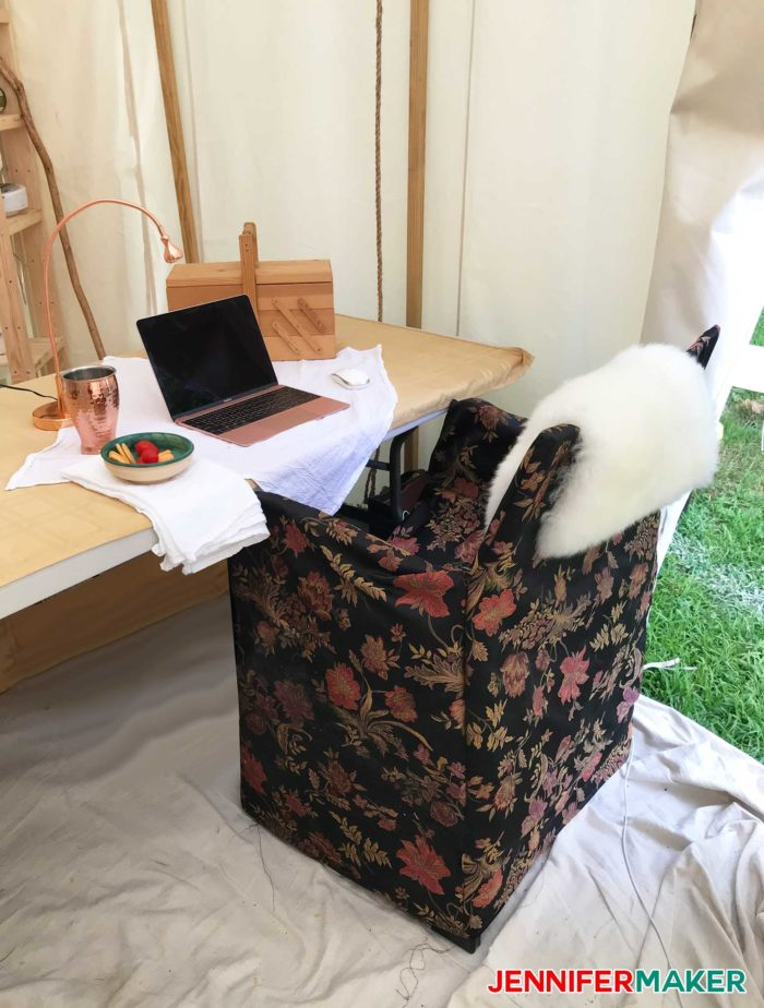 Glamping workspace with upholstered chair and table makes a great DIY glamping idea