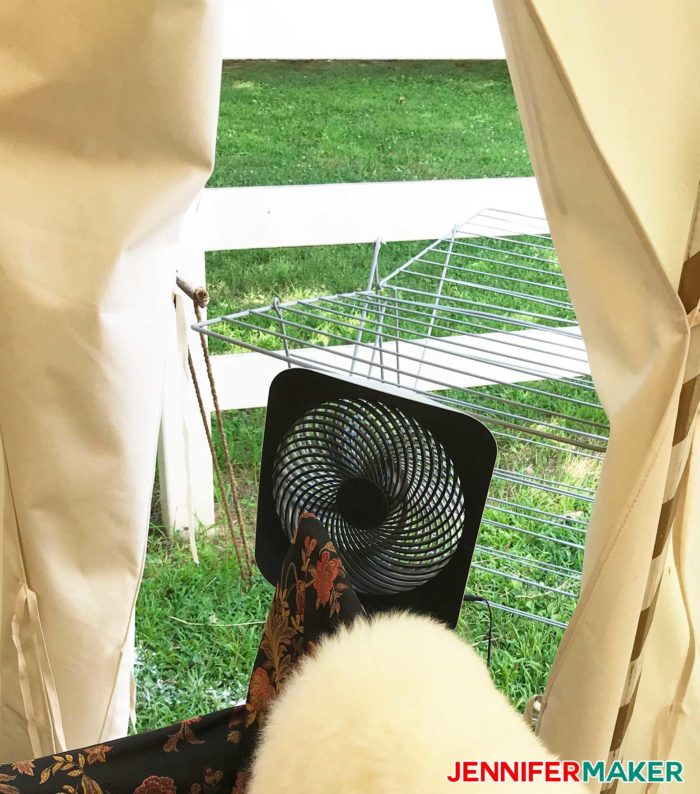 A fan in front of an open door can really cool off a glamping pavilion