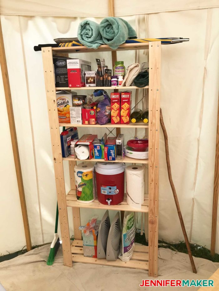 A simple wooden shelf makes a great DIY glamping idea for storage