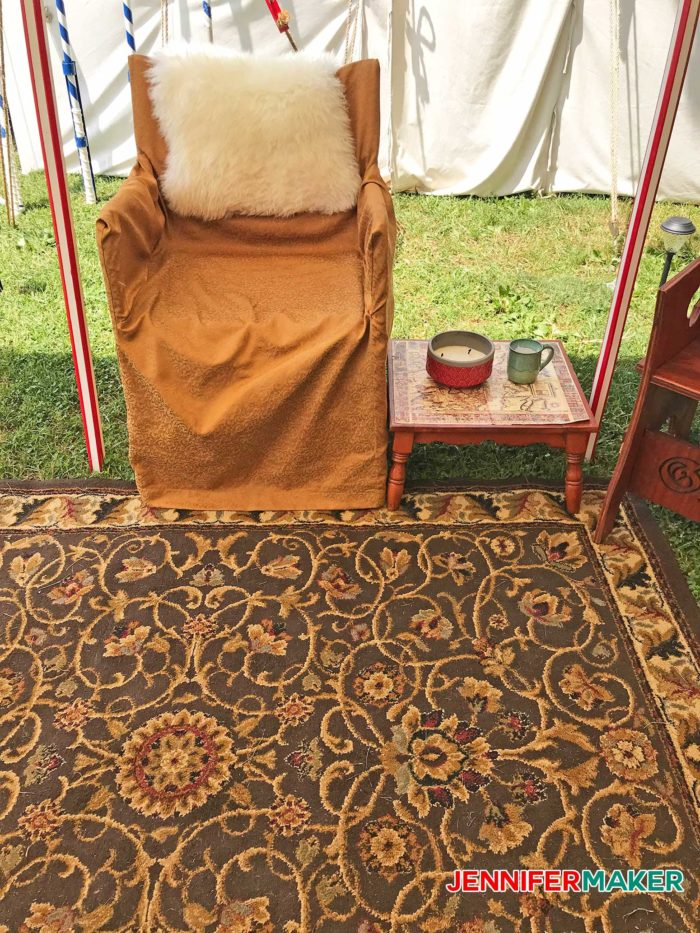 DIY Glamping Chair upholstered in gold with a sheepskin throw