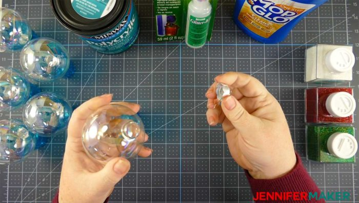 Remove the aluminum top from your clear ornament before making DIY glitter ornaments