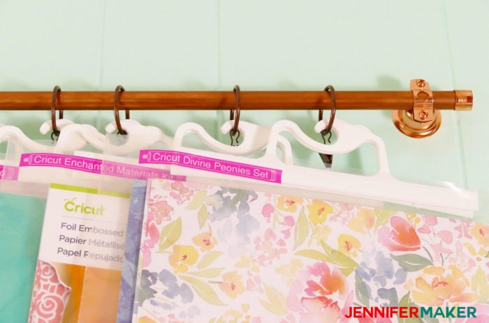 Put craft supplies in clear hangup bags and hang from curtain rods to make your own DIY hanging storage system