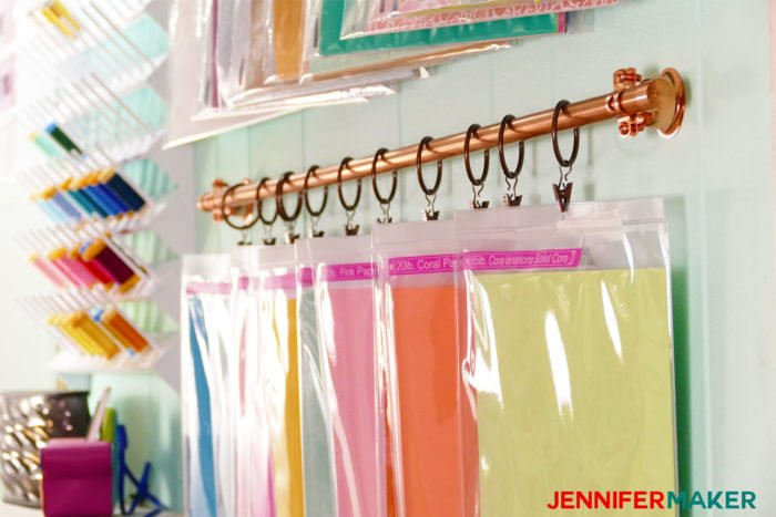 Clips bags to curtain rings and hang from curtain rods to make your own DIY hanging storage system