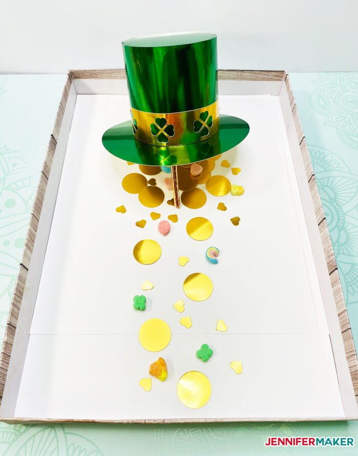DIY Leprechaun Trap Craft made with a DIY paper hat and gold paper coins and Lucky Charms