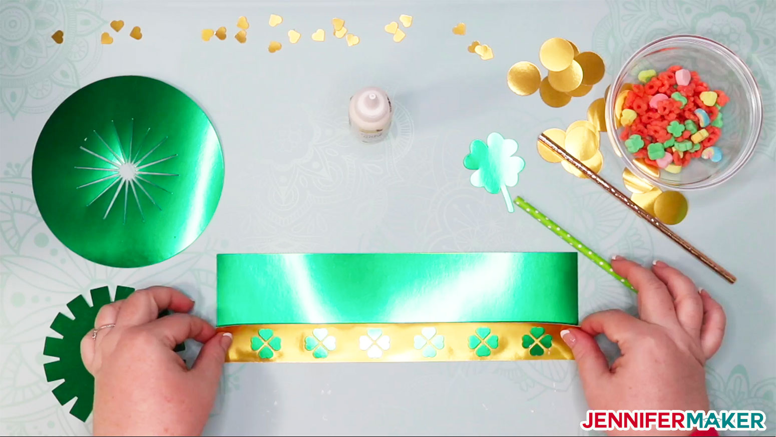Attaching the gold hat band to the green paper hat to make a DIY paper hat and leprechaun trap
