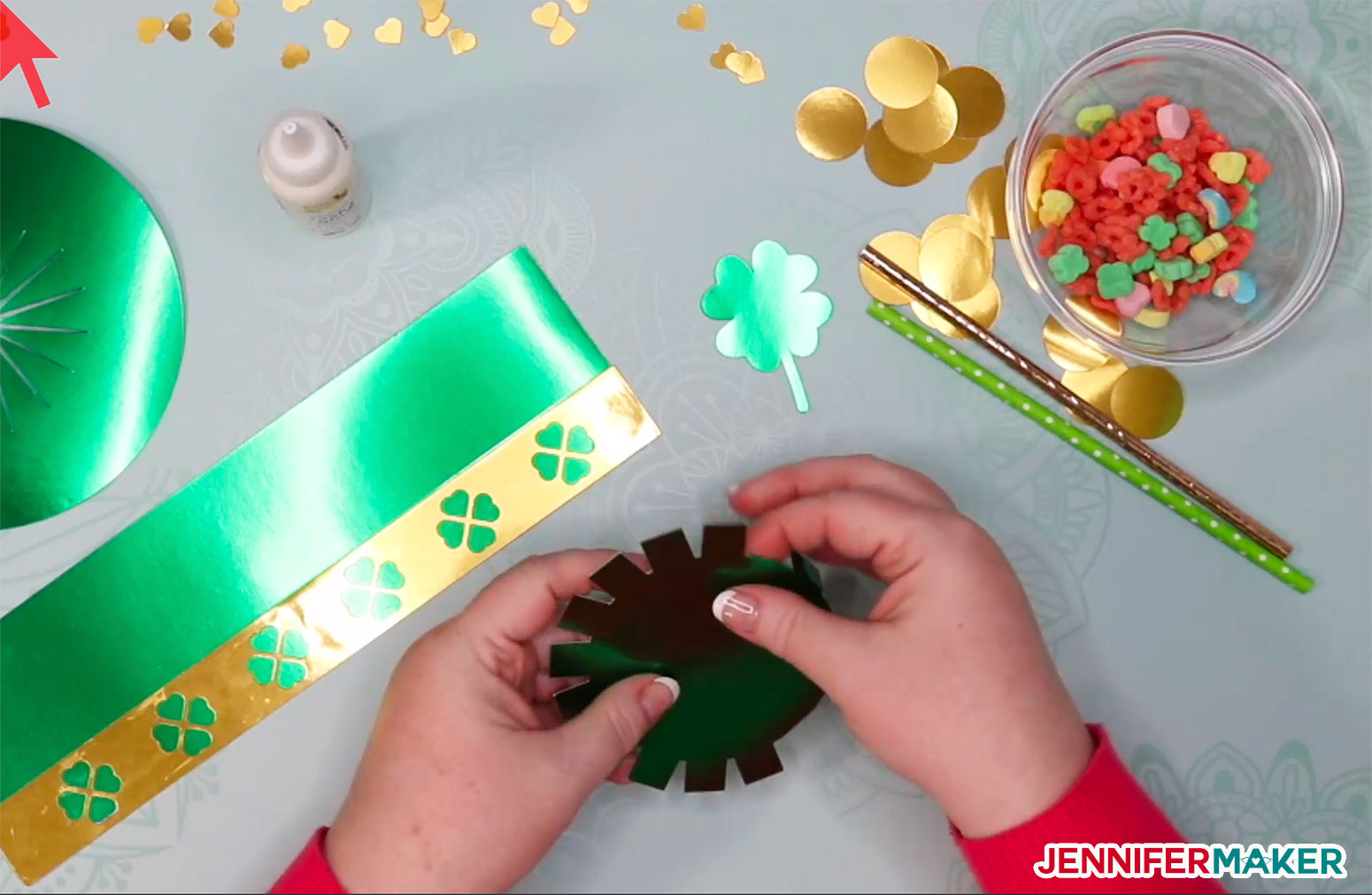 Folding the hat top tabs in for the DIY paper hat and leprechaun trap