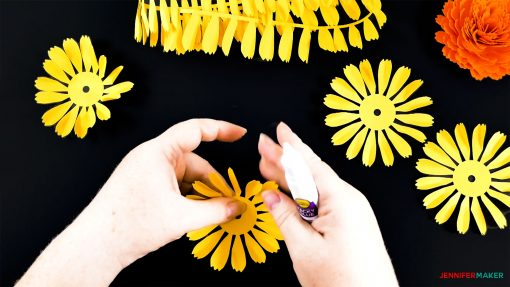 Folding up the base petals of the DIY paper marigold