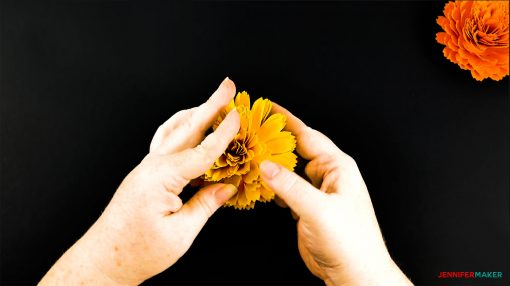 Fluffing the petals on the DIY paper marigold