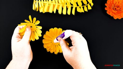 Gluing the base petals together of the DIY paper marigold