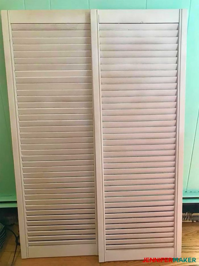 Old white shutters ready to be repurposed into a DIY paper organizer