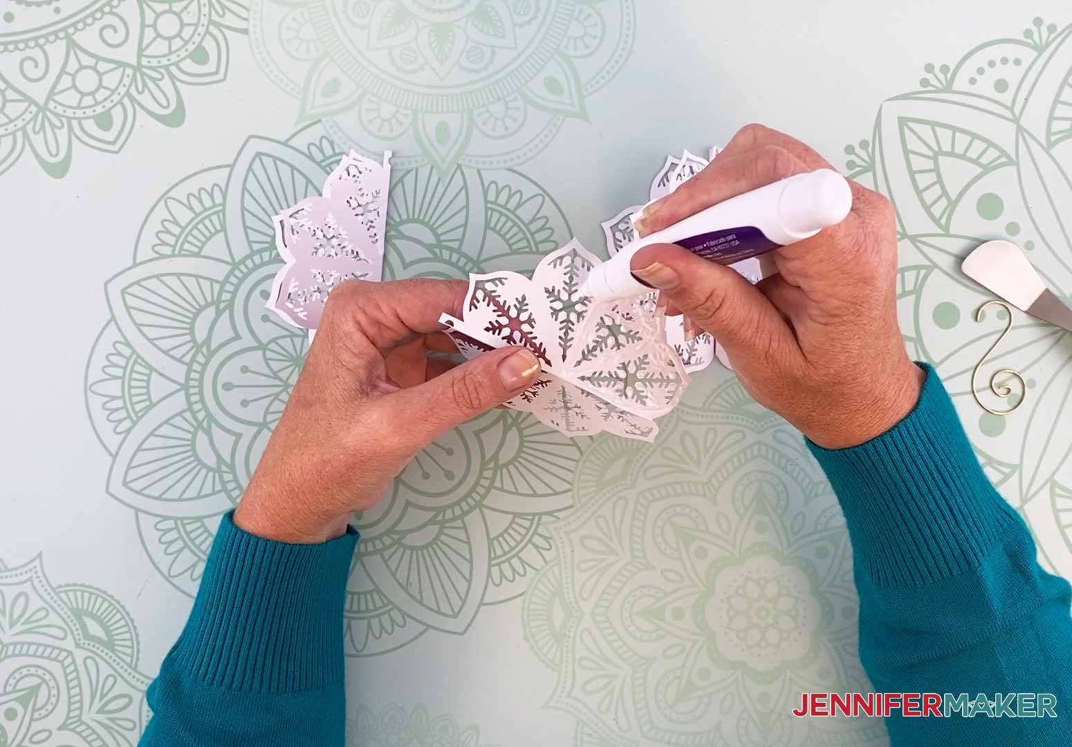 Add glue to one half of the diy paper ornament