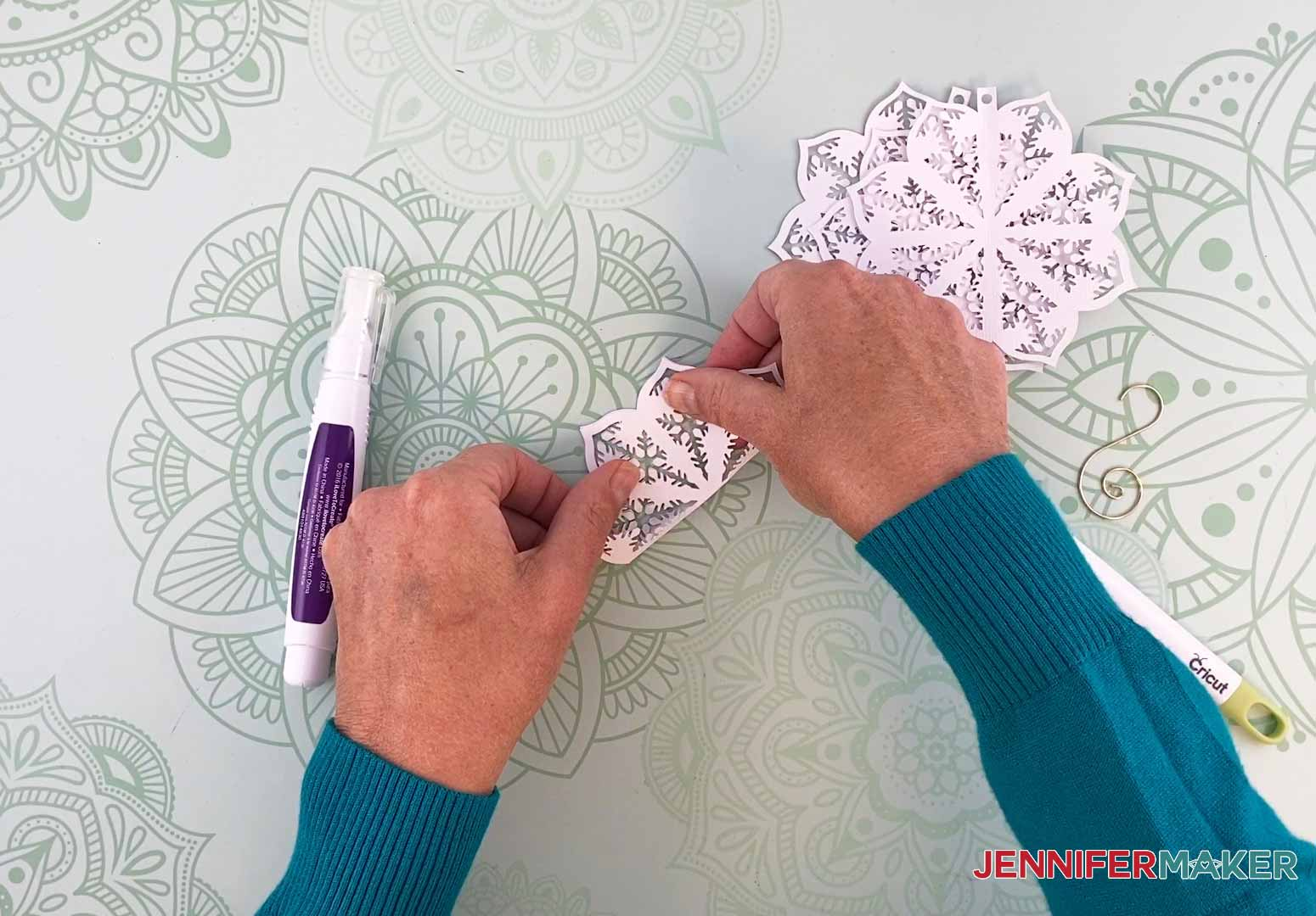 Fold the first piece in half for my diy paper ornament