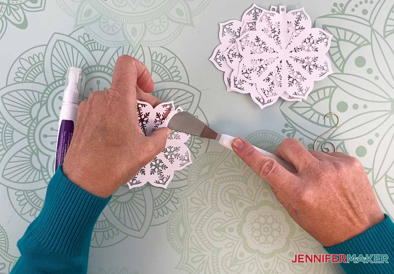 Use a Cricut spatula to help fold the score line for my diy paper ornament