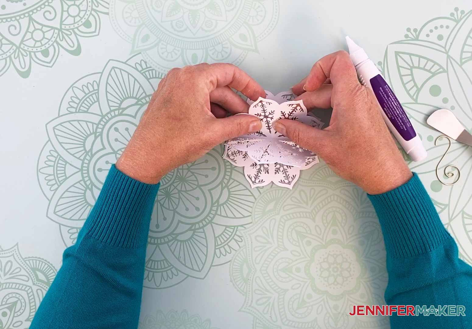 Align and glue together the final two sides of my diy paper ornament