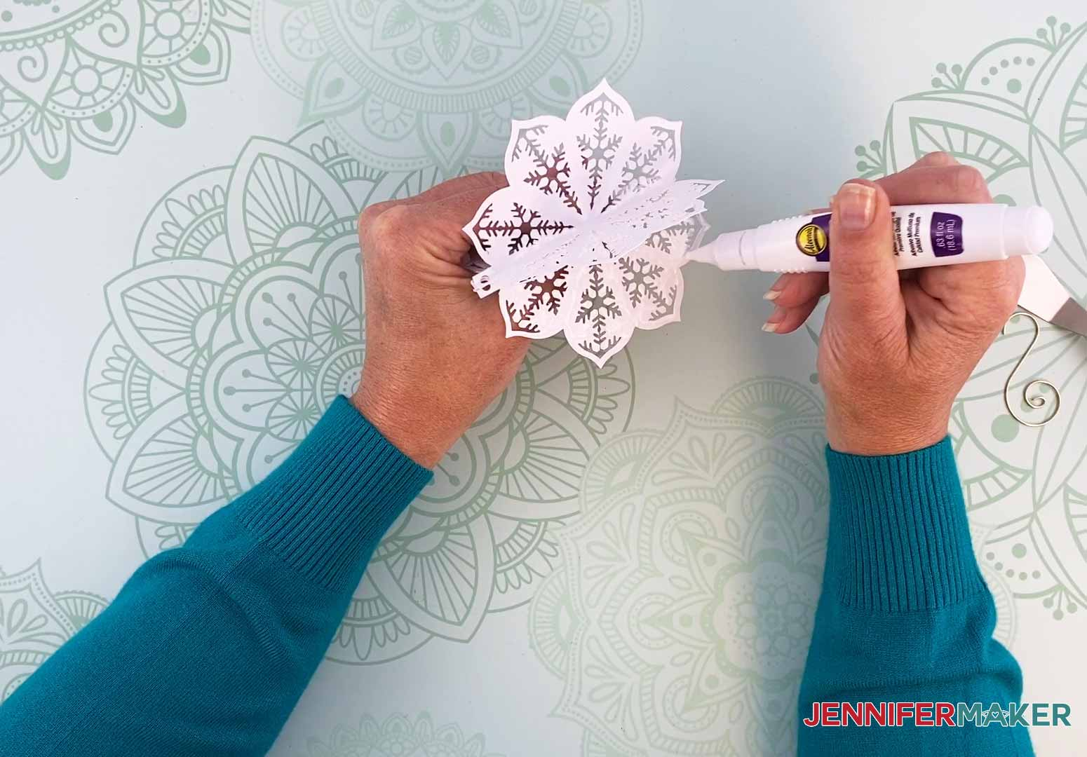 Add glue to the last panel of my diy paper ornament