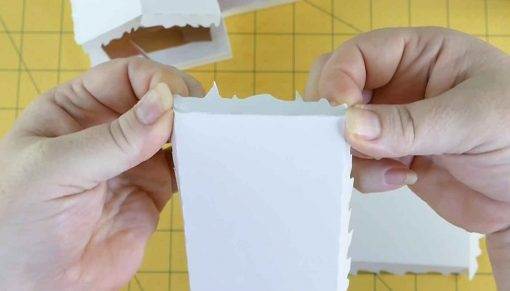 Fold and glue the tabs on the roof
