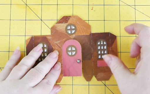 Attach the door to the portico of the diy paper village house