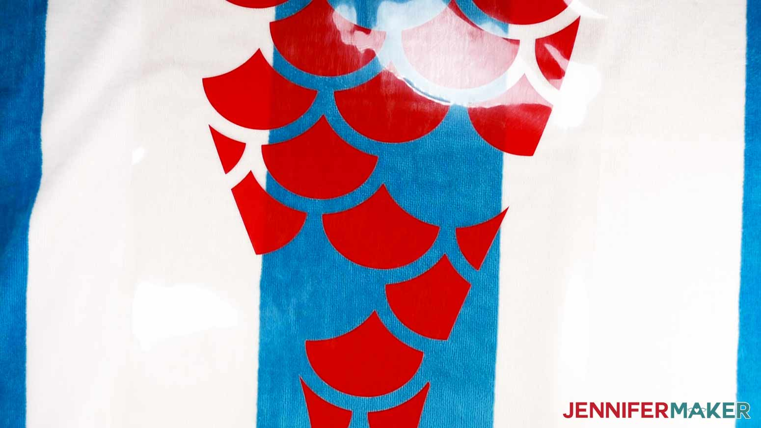 Aligning the Red Iron-On layer of the Mermaid DIY Personalized Beach Towels