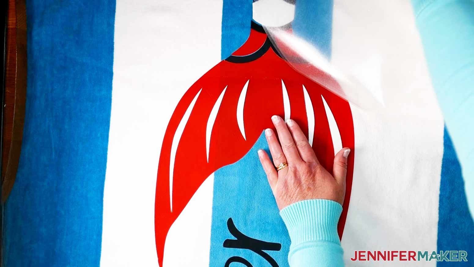 Removing the White Glitter Iron-On carrier sheet from the Mermaid DIY Personalized Beach Towel