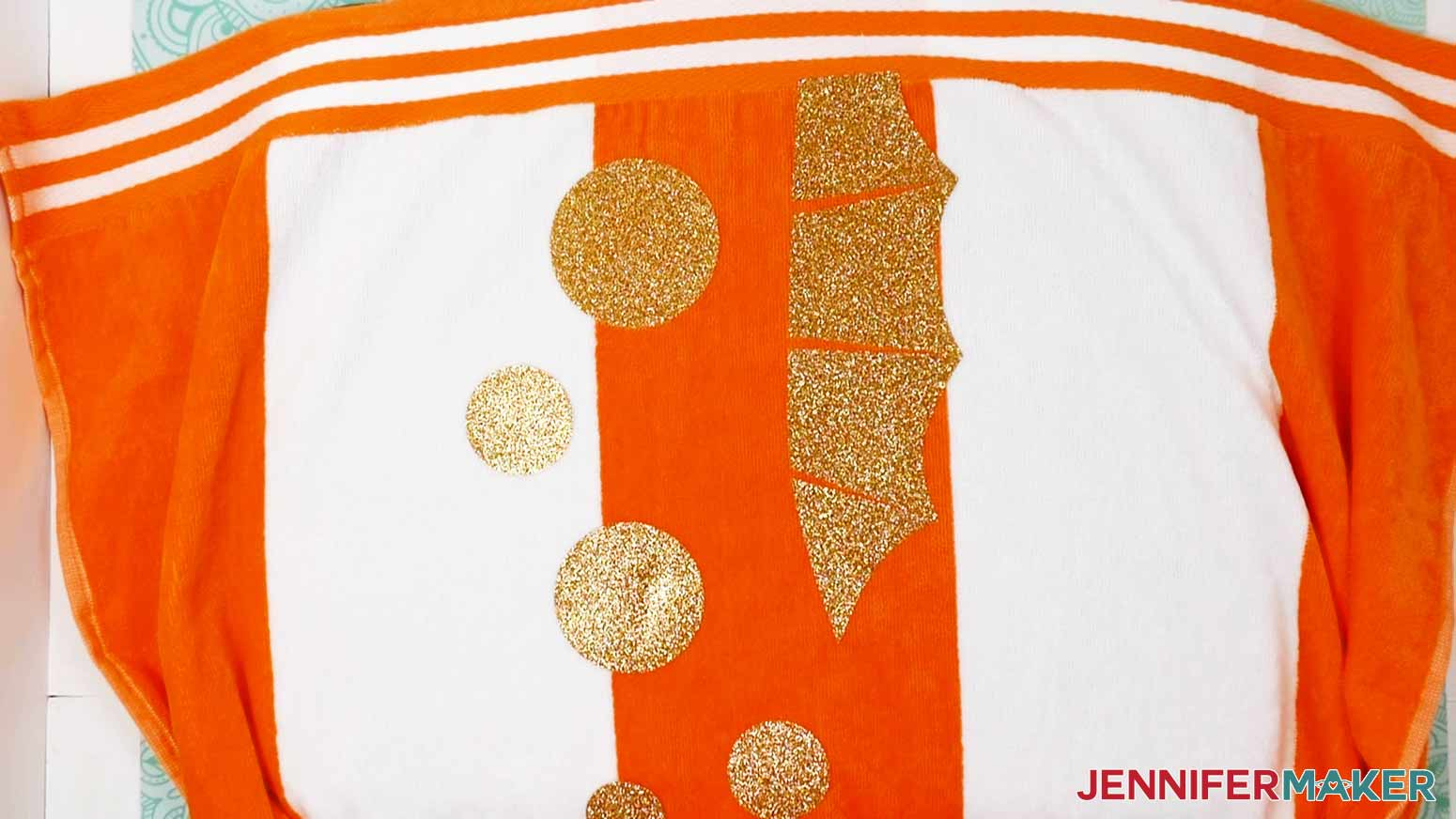 Gold Glitter Iron-On tacked onto the DIY Personalized Beach Towels