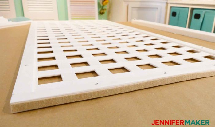 Stick felt pads to the bottom of your DIY pet / baby gate panels to protect your floors