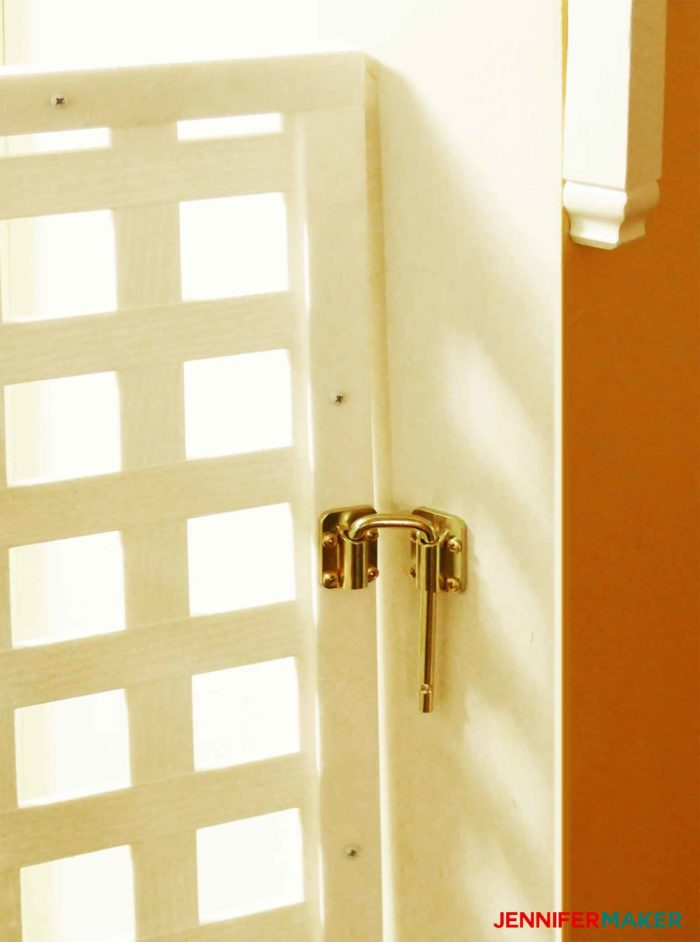 Sliding door latch attached to a wall to secure a DIY pet gate