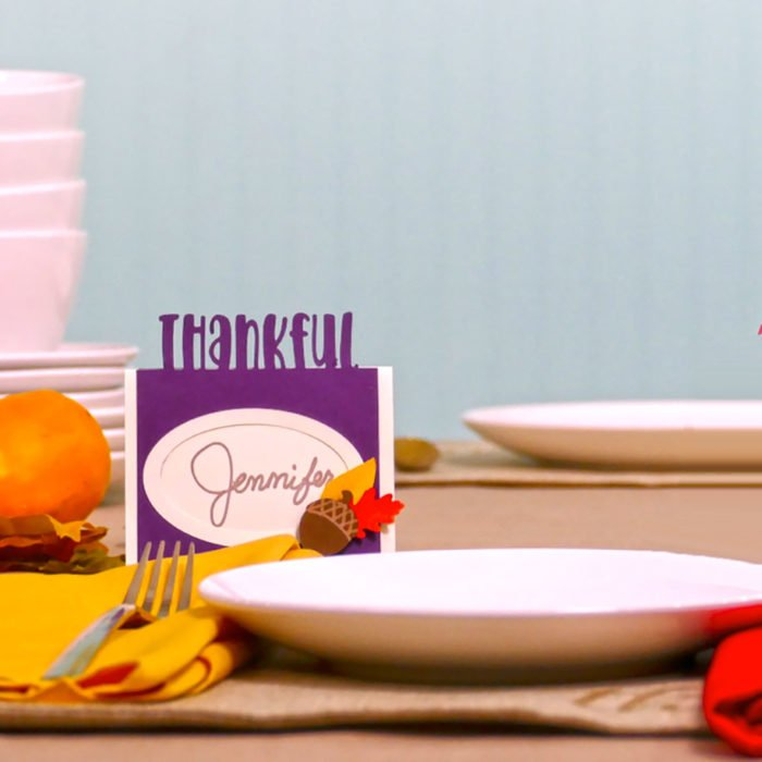 A purple Thankful DIY place card made for Thanksgiving dinner