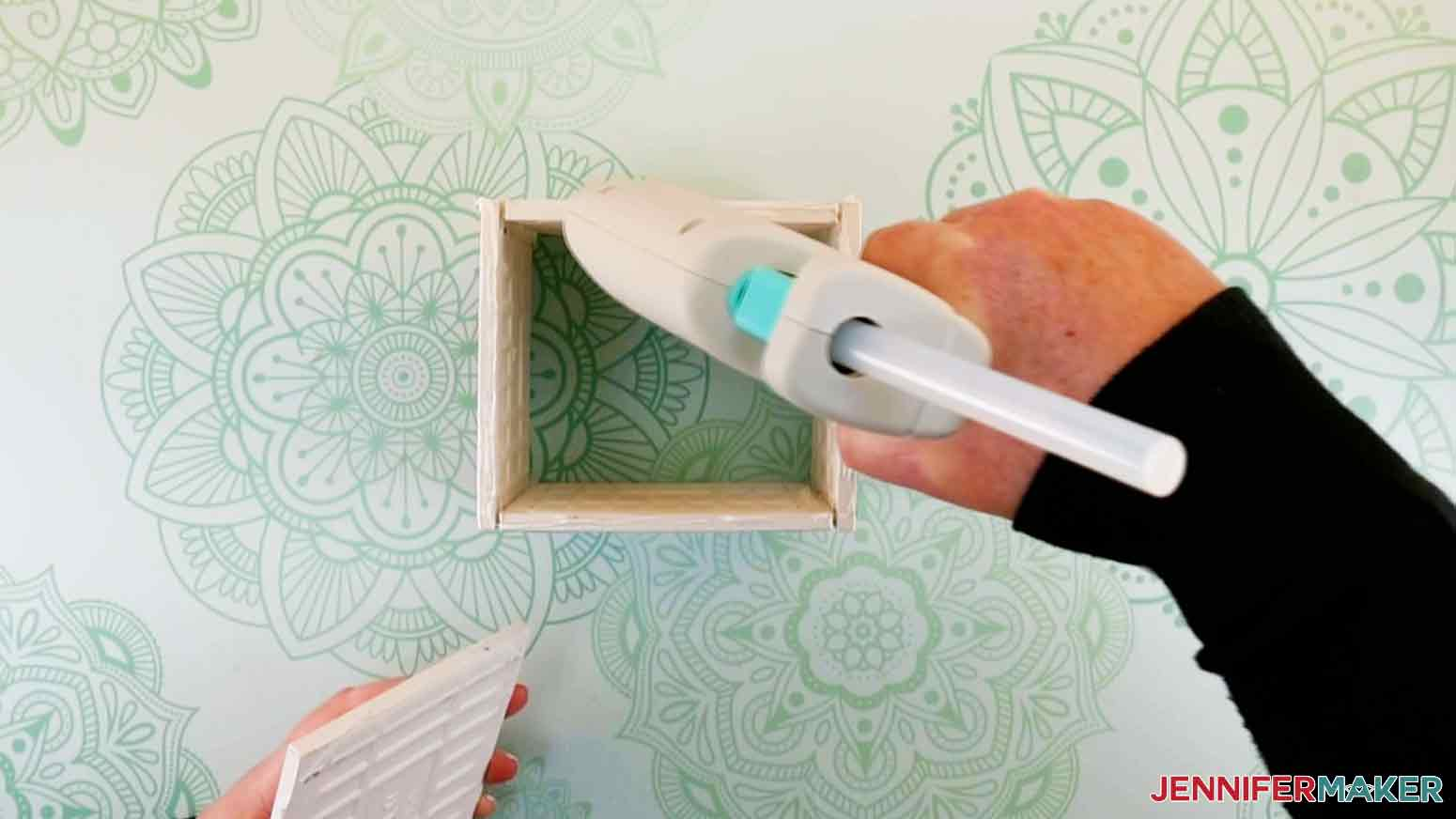 Add hot glue to the bottom edges of the tiles for my DIY Plant Pot with Tiles project