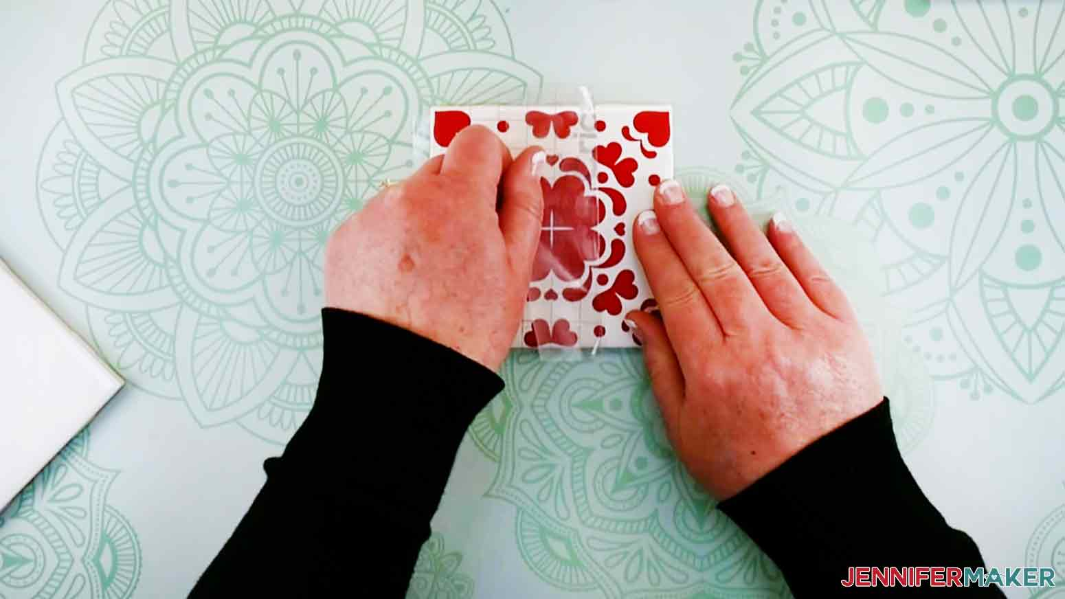 Carefully remove the transfer tape from the vinyl for my DIY Plant Pot with Tiles design