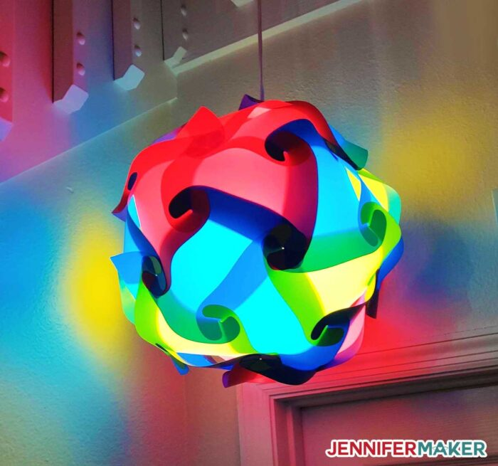 DIY Puzzle Lamp in multiple colors hanging from a ceiling