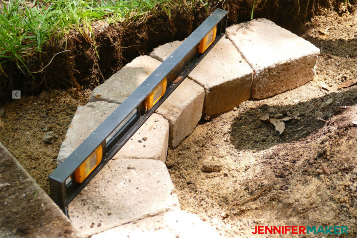 DIY retaining wall using wedge shaped bricks to make a neat curve