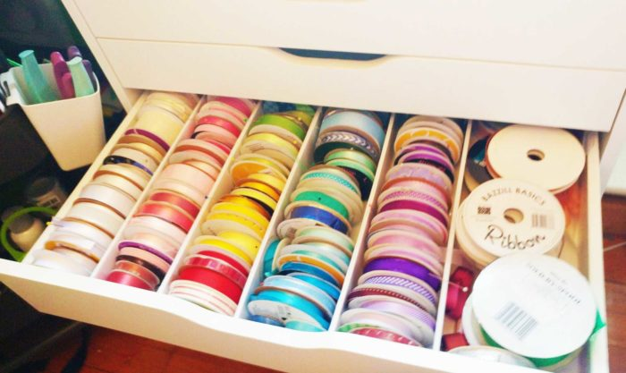 Ribbon spools stored in an Alex drawer with dividers for DIY ribbon storage
