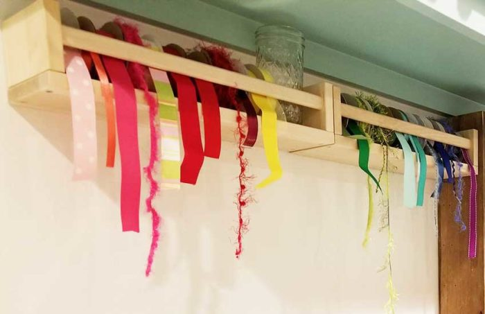 Ribbon stored in IKEA spice racks keeps everything organized