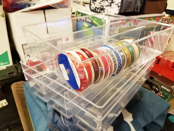 Craft ribbon stored in clear kitchen organizer trays