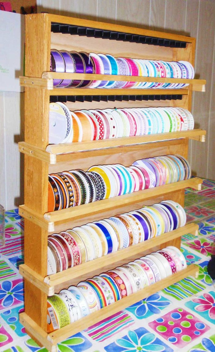 Upcycle an old cassette tape rack to create a ribbon storage organizer