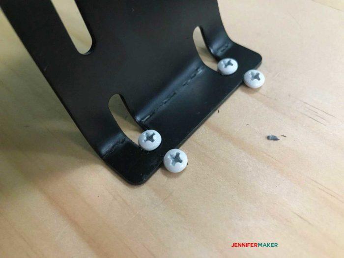 Screws holding down the DIY Tumbler turner bracket