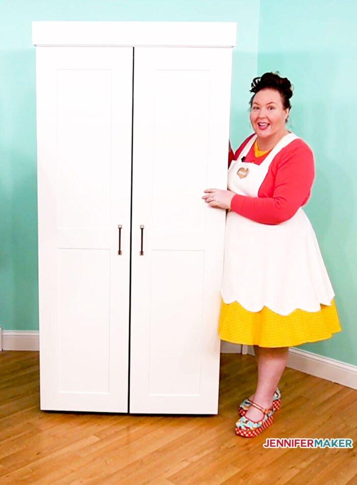 Jennifer and her white DreamBox craft storage armoire
