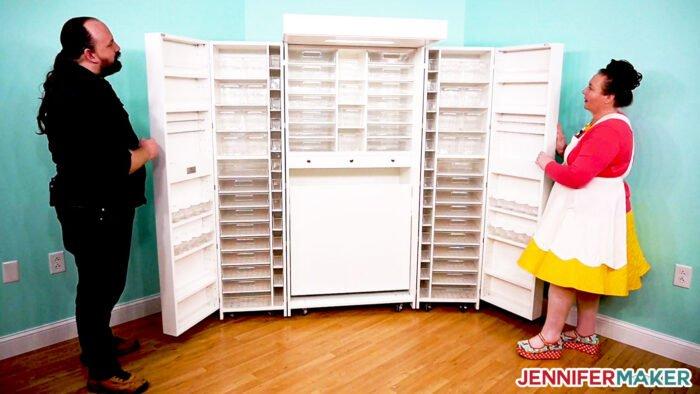 Jennifer opening her white DreamBox craft storage armoire