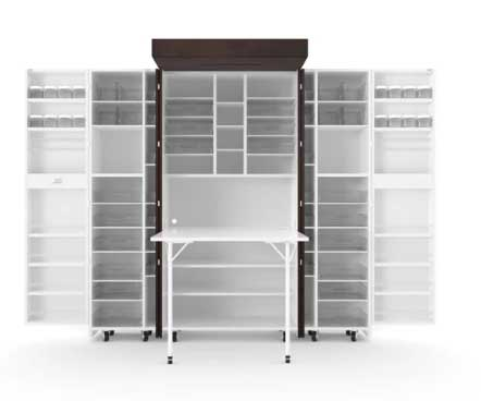 A DreamBox craft organization armoire open with the table extended