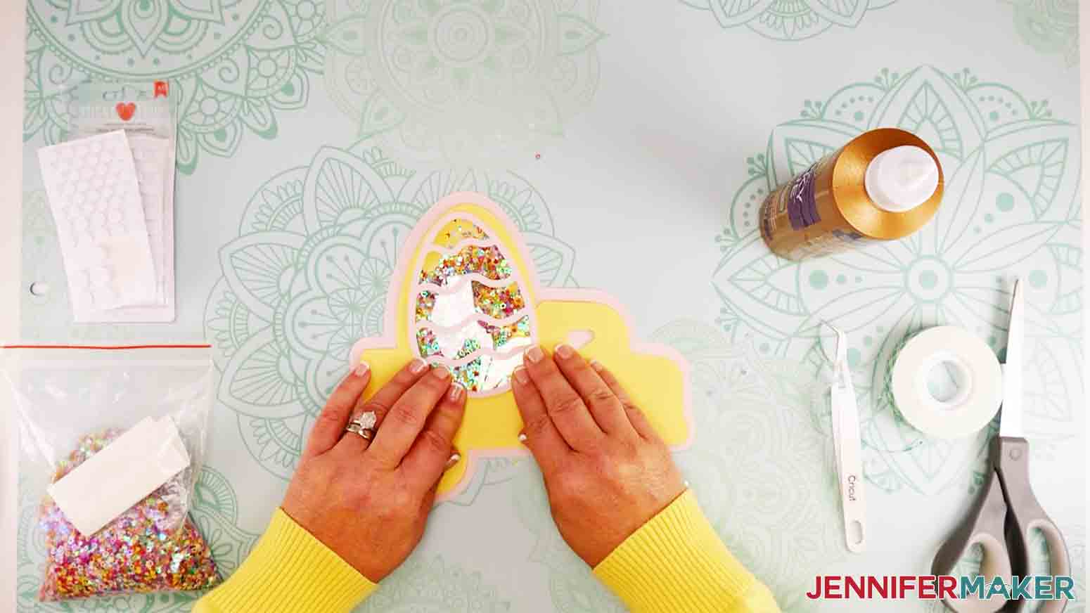 easter truck decor adding glitter shaker egg and pressing to seal tape