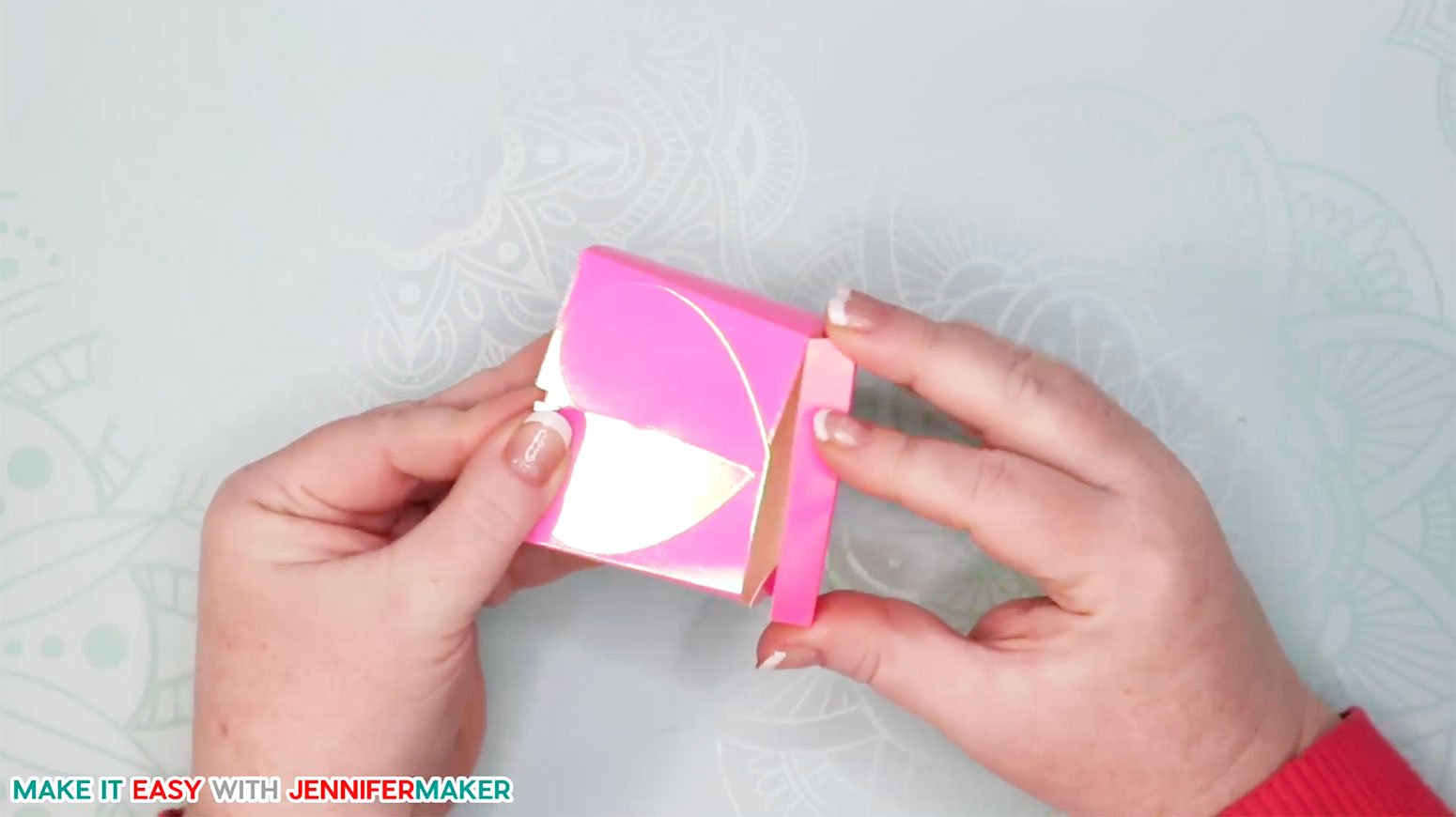 Tucking the bottom tab into the heart box