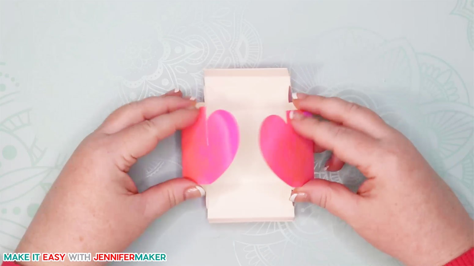 Fold up the easy paper heart box so the two sides meet and slot