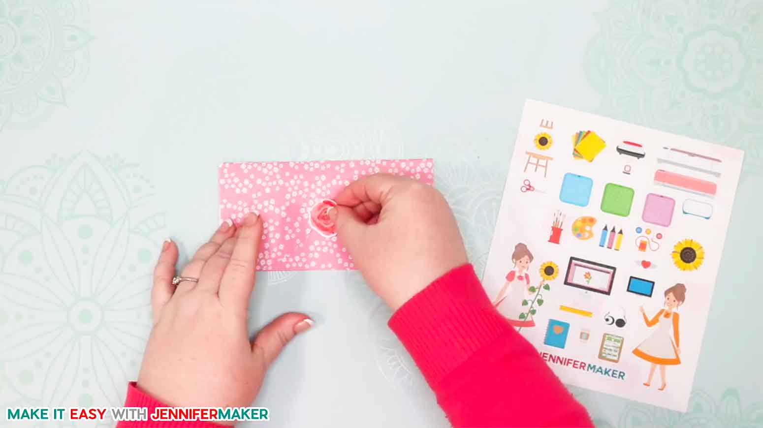 Placing a sticker on the easy heart envelope card to keep it closed