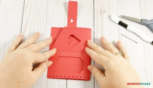 Fold your wallet in half to create the right shape
