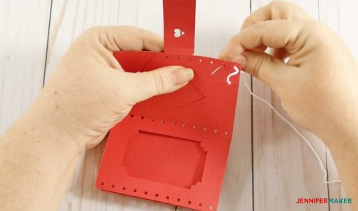 Continue stitching your leather wallet with the embroidery floss