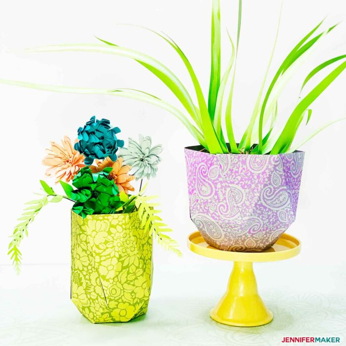 Two pretty and easy paper vases filled with paper flowers and paper plants